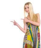 Girl in dress pointing on copy space Royalty Free Stock Photo