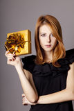 Girl in dress with present box Stock Images