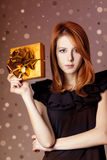 Girl in dress with present box Royalty Free Stock Images