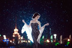 The girl in the dress in the rain stock photography