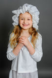 Girl in dress rustic vintage on a gray background. Laughing Royalty Free Stock Images