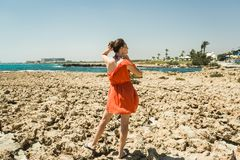 Girl in dress on the shore of the Mediterranean Sea Royalty Free Stock Images