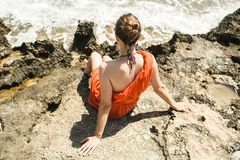 Girl in dress on the shore of the Mediterranean Sea Stock Photos