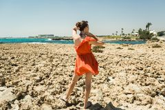 Girl in dress on the shore of the Mediterranean Sea Stock Photography