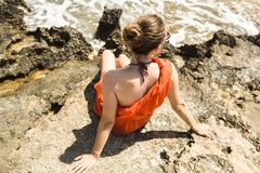 Girl in dress on the shore of the Mediterranean Sea Stock Photo