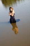 Girl  a dress stand in lake  the summer Royalty Free Stock Photos