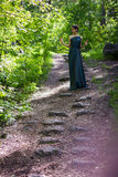 Girl in dress standing on the hill. Girl in dress standing on hill Royalty Free Stock Photography