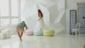 Girl in a dress steps on huge macaroons stock video