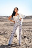 Girl in dress in sunny desert. Woman in white dress in sand dunes. Wedding fashion and beauty salon. Bride and wedding ceremony. Elegance and fashion model stock images