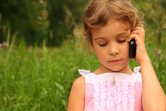 Girl in dress talking on cell phone Stock Photography