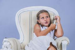 Girl in dress talking with old phone with surprised face stock photos