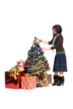 Girl dress up a Christmas tree Stock Photography