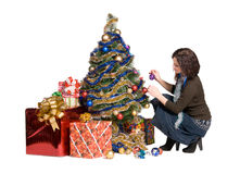 Girl dress up a Christmas tree Royalty Free Stock Image