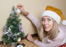 Girl dress up christmas tree Royalty Free Stock Photography