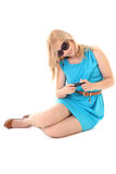 Girl in dress using mobile phone Stock Image