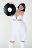 Girl in dress with vinyl disc Stock Image