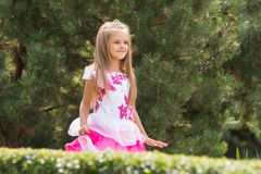 Girl in dress walking in the garden Royalty Free Stock Image