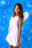 Girl dressed as an angel Stock Photography