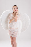 Girl dressed as an angel Stock Images