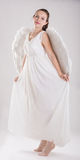 Girl dressed as an angel Stock Image