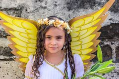Girl dressed as an angel in parade, Guatemala. Cuidad Vieja,, Guatemala -  December 7, 2017: Girl dressed as angel in parade celebrating Our Lady of the Royalty Free Stock Photography