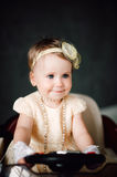 Girl dressed as bride playing with toy car Stock Photos