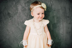 Girl dressed as bride playing with toy car Royalty Free Stock Photography