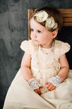 Girl dressed as bride playing with toy car Royalty Free Stock Photos