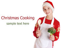 Girl dressed as a Christmas elf on background. Stock Images