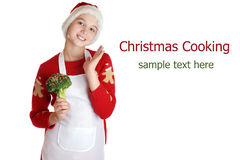 Girl dressed as a Christmas elf on background. Royalty Free Stock Photo