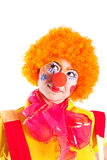 A girl dressed as a clown is looking up Stock Image