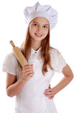 Girl dressed as a cook holding a rolling pin Royalty Free Stock Photos