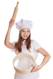 Girl dressed as a cook holding a rolling pin Royalty Free Stock Photo