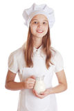 Girl dressed as a cook holding a rolling pin Royalty Free Stock Images