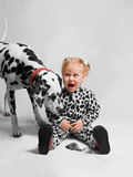Girl dressed as Dalmatian afraid mouse Royalty Free Stock Image