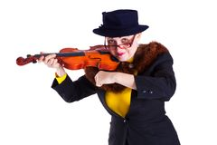 Girl dressed as an old lady playing the violin Royalty Free Stock Photo