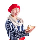 Girl dressed as a pirate with a seashell Stock Photo