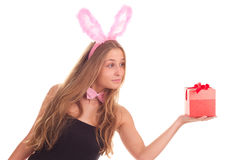 A girl dressed as a rabbit with gifts. Studio shooting Royalty Free Stock Image