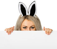 A girl dressed as a rabbit with a poster Royalty Free Stock Images