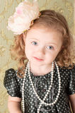 Girl dressed as a retro doll Royalty Free Stock Photos