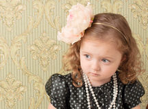 Girl dressed as a retro doll Royalty Free Stock Photo