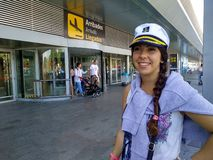 Girl dressed as a sailor ready to leave outside the airport stock photo
