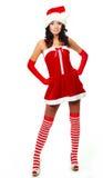 Girl dressed as Santa Stock Images