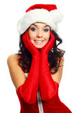 Girl dressed as Santa. Beautiful brunette girl dressed as Santa against white background Stock Photo