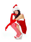 Girl dressed as Santa. Beautiful brunette girl dressed as Santa against white background Stock Photos
