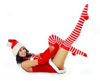 Girl dressed as Santa. Pretty brunette girl dressed as Santa on the floor Stock Photography