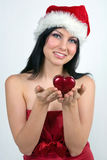 Girl dressed as Santa. Holding a heart Stock Photography