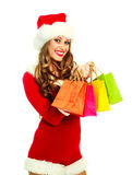 Girl dressed as Santa with bags Royalty Free Stock Photo