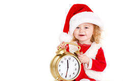 Girl dressed as Santa with a big clock Royalty Free Stock Image