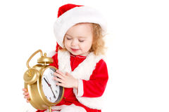 Girl dressed as Santa with a big clock Royalty Free Stock Photos